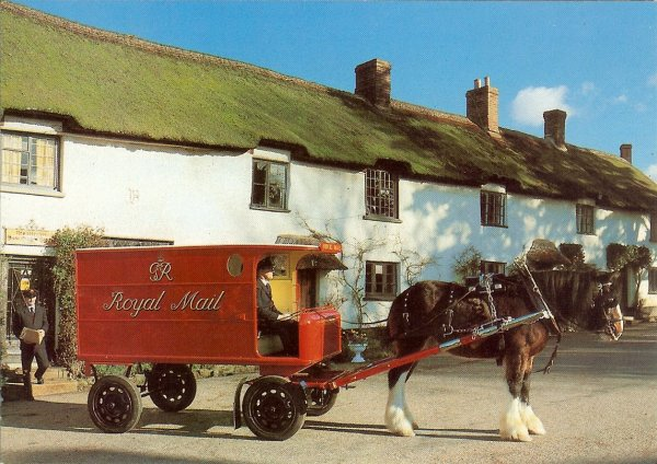 horse drawn mail van outside whitewashed thatched post office