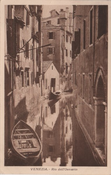 sepia postcard of Venice canal