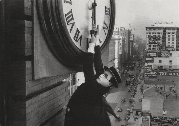 postcard of Harold Lloyd hanging from clock
