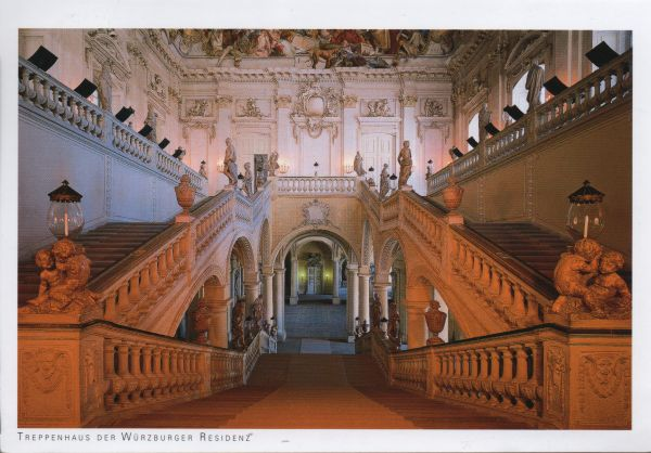 grand double staircase with white balusters