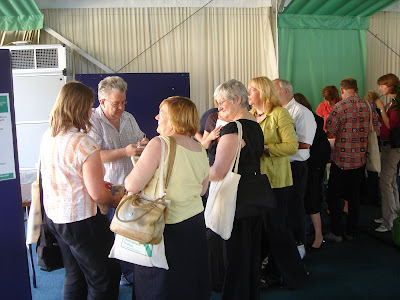 Ian McMillan signing his books at the Leeds Met Staff Development Festival, Innovation North Faculty Day