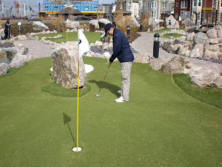 Emily Gottfried playing the Adventure Golf course at Blackpool Pleasure Beach