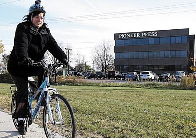 Image of columnist Ruth Solomon on her bicycle