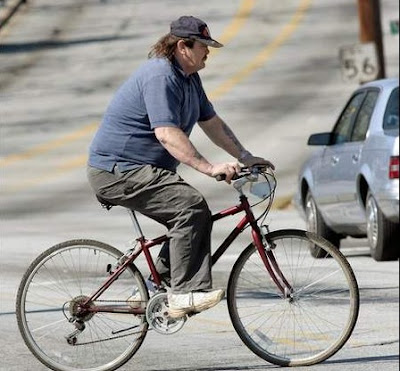 Image of bicyclist crossing Henry Street after a sunny morning ride on the Hub City Connector trail in Spartanburg Tuesday morning.