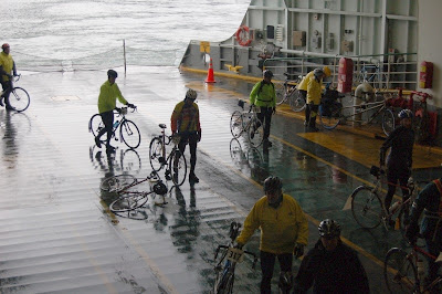 Image of bicyclists boarding ferry in Seattle