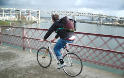 Image of bicyclist on the Hawthorne Bridge in Portland, Oregon