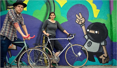 Image of older bikes in front of mural in Los Angeles