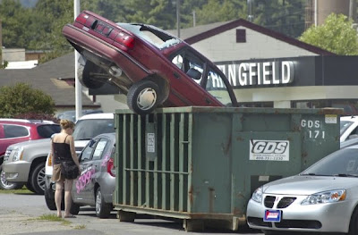 Image of car in dumpster
