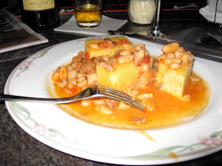 Baked polenta with sausage and bean sauce