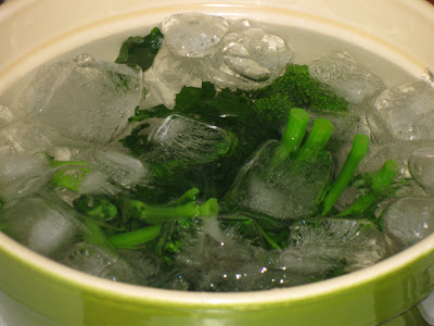 Broccoli rabe cooling in ice bath