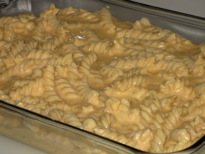 Pour pasta mixture into a baking dish