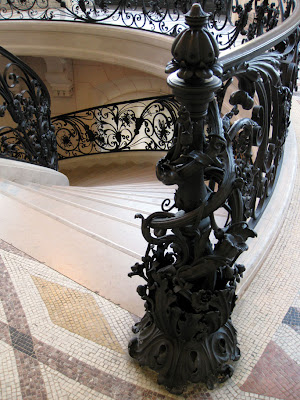 Elaborate wrought iron newel - Le Petit Palais