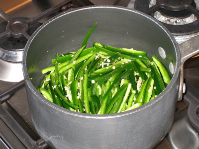 Soften jalapeños in boiling water and vinegar
