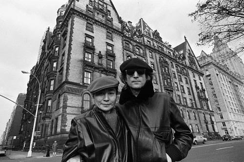 John and Yoko in front of the Dakota