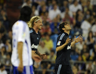 Kaka celebrating his goal with Guti