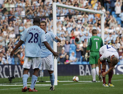Manchester City striker Daniel Sturridge congratulates his team-mate Elano after the Brazilian put the home side two goals clear against 10-man West Ham United yesterday