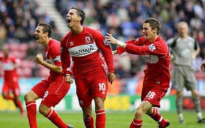 Late joy: Jeremie Aliadiere (c) celebrates after scoring for Boro at the death