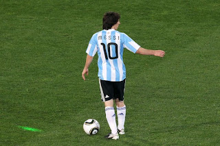 Lionel Messi of Argentina's national football team runs with the ball during 2010 FIFA World Cup South Africa Group B, Match between Argentina and Nigeria at Ellis Park Stadium on June 12 in Johannesburg, South Africa.