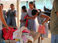 schoolgirls receiving donated clothing