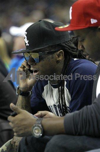 Fotos: Lil Wayne no jogo do Hornets vs. Spurs