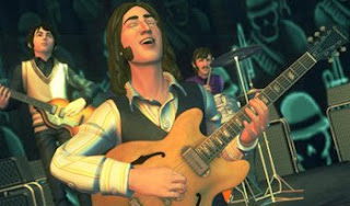 the beatle play on stage in rock band video game