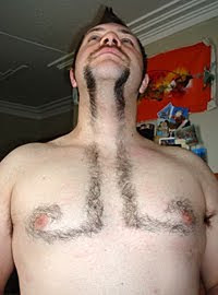 man with moustache and his chest hair cut to extend look
