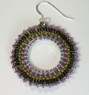 Brick Stitch Earrings in Beading http://caravanbeads.blogspot.com/2011_01_01_archive.html