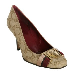 Wow, these gorgeous Gucci pumps would go great with that purse I was eyeing ...