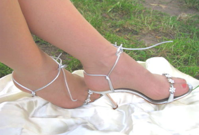 picture of pretty feet in strappy silver sandals
