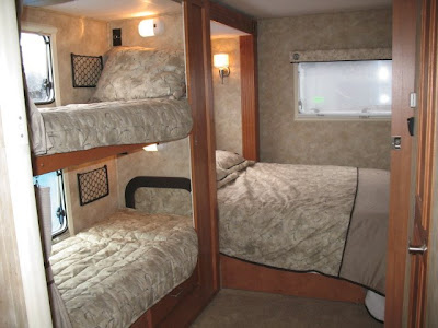 Rv travels with ed and camille long view rv superstore for Rv with 2 master bedrooms