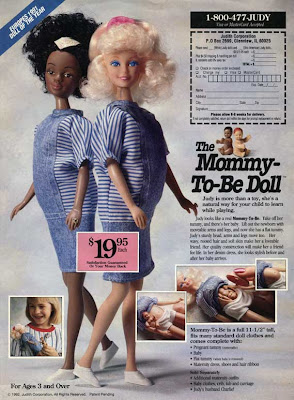 Ad for Mommy-To-Be dolls, with white and black pregnant dolls pictured