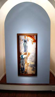 A tall vertical painting of two women shown at the front of a church-like space