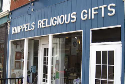 Storefront with sign over window - Knippels Religious Gifts