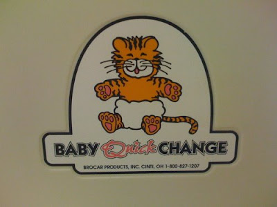 Cute orange tiger in a diaper, label says Baby Quick Change