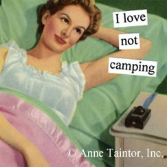 Woman reclining in bed, thinking I love not camping