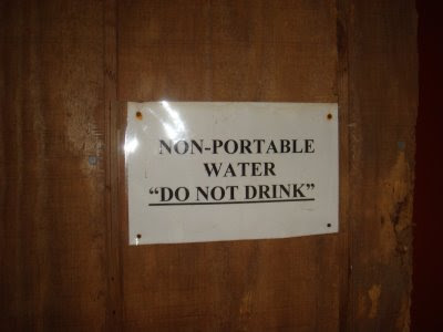 Laserprinted sign reading NON-PORTABLE WATER 'DO NOT DRINK'