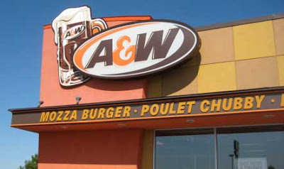 Exterior signage on an A&W fast food restaurant, featuring something called Poulet Chubby
