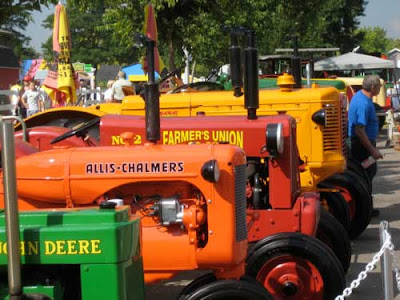 Orange, green and red tractors