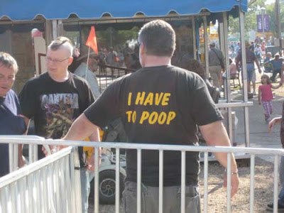 Back of a man's shirt that says I have to poop