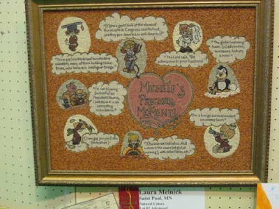 Pink heart with title in center, surrounded by cartoon balloons and pictures all in tiny seeds