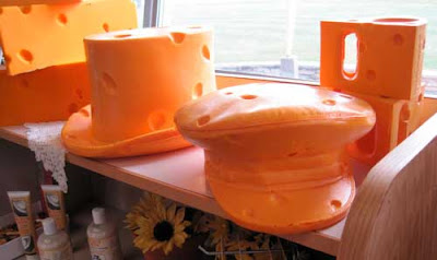 Orange fake cheese shaped like a top hat and a cap