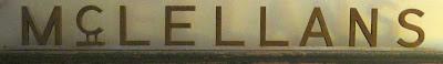 Sans serif metal letters reading McLELLANS, shot straight on