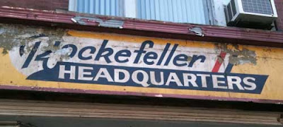 Hand-painted sign reading Rockefeller Headquarters