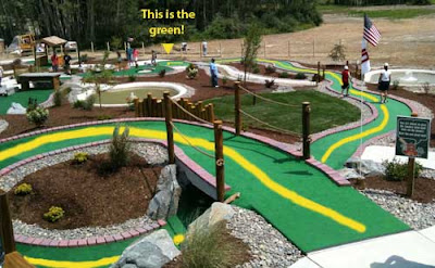 Corkscrew minigolf hole that seems to go on forever