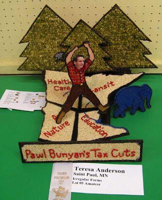 Tim Pawlenty as Paul Bunyan, axing Minnesota into pieces