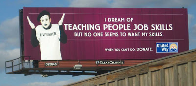 Dark billboard with a mime in a white shirt that says LIVE UNITED. Headline says I dream of teaching people job skills but no one seems to want my skills. Followed by the United Way  logo