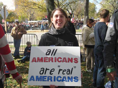 All Americans are REAL Americans, black, red and blue marker on white poster board