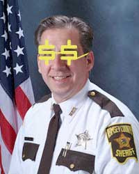 Sheriff Bob Fletcher Photoshopped to wear yellow dollar sign glasses