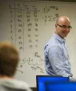 John Abraham teaching a class