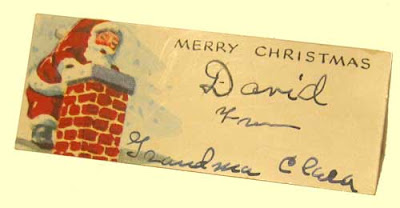 Christmas gift tag handwritten in fountain pen ink To David from Grandma Clara, with Santa Claus illustration